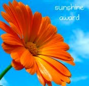 Orange flower with the text Sunshine award