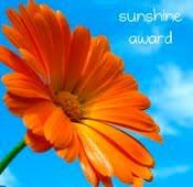 Orange flower with the text Sunshine award